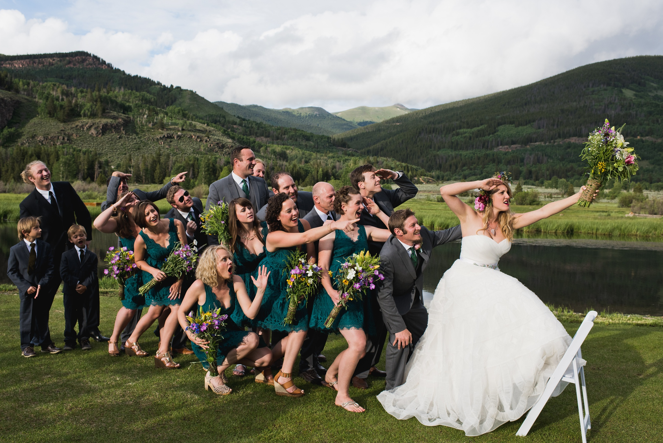 A bridal party has some fun and recreates Washington Crossing the Delaware at at wedding at Camp Hale near Vail, Colorado. Wedding photography by Sonja Salzburg of Sonja K Photography.