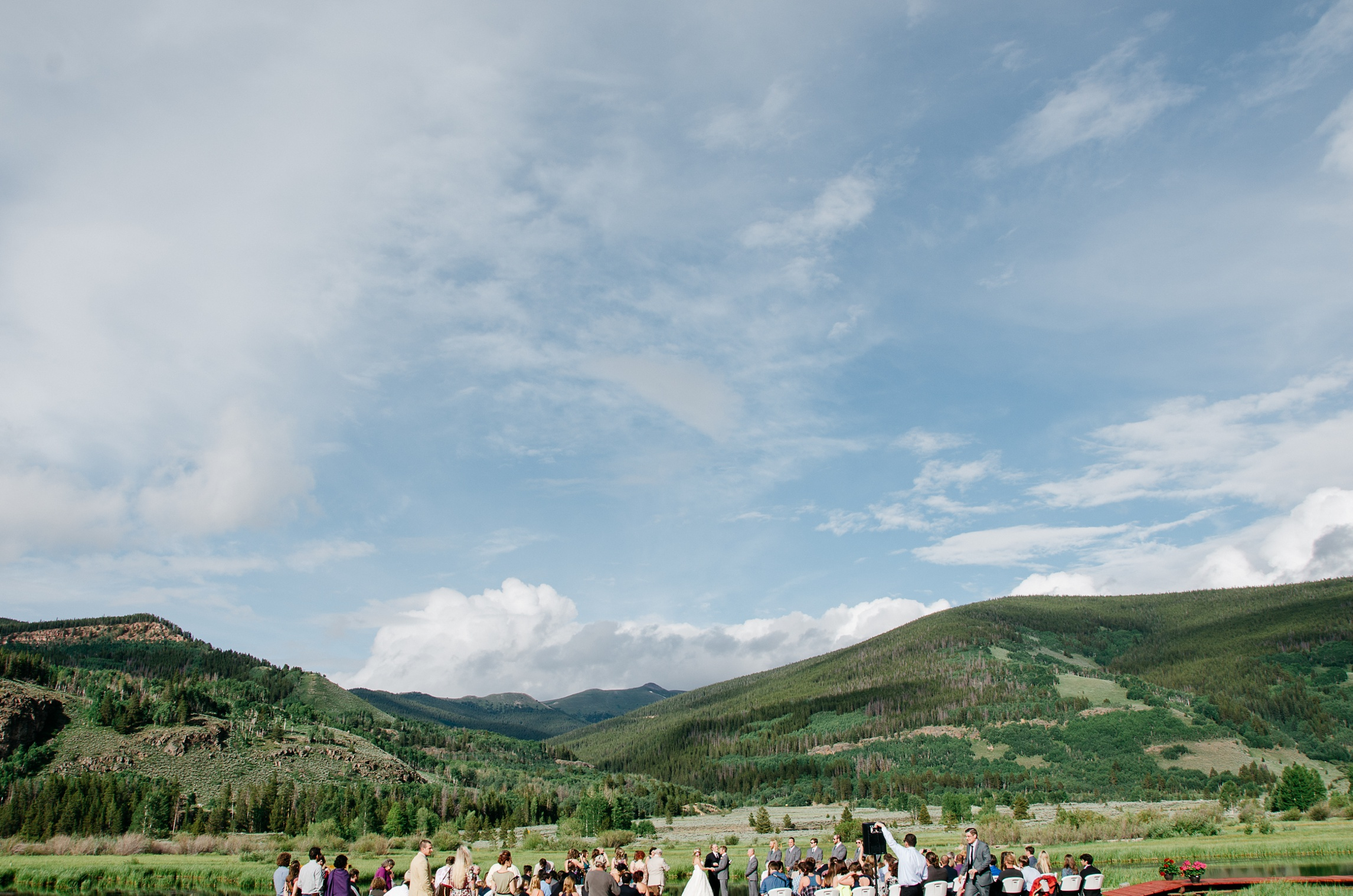 A mountain wedding at Camp Hale near Vail, Colorado. Wedding photography by Sonja Salzburg of Sonja K Photography.