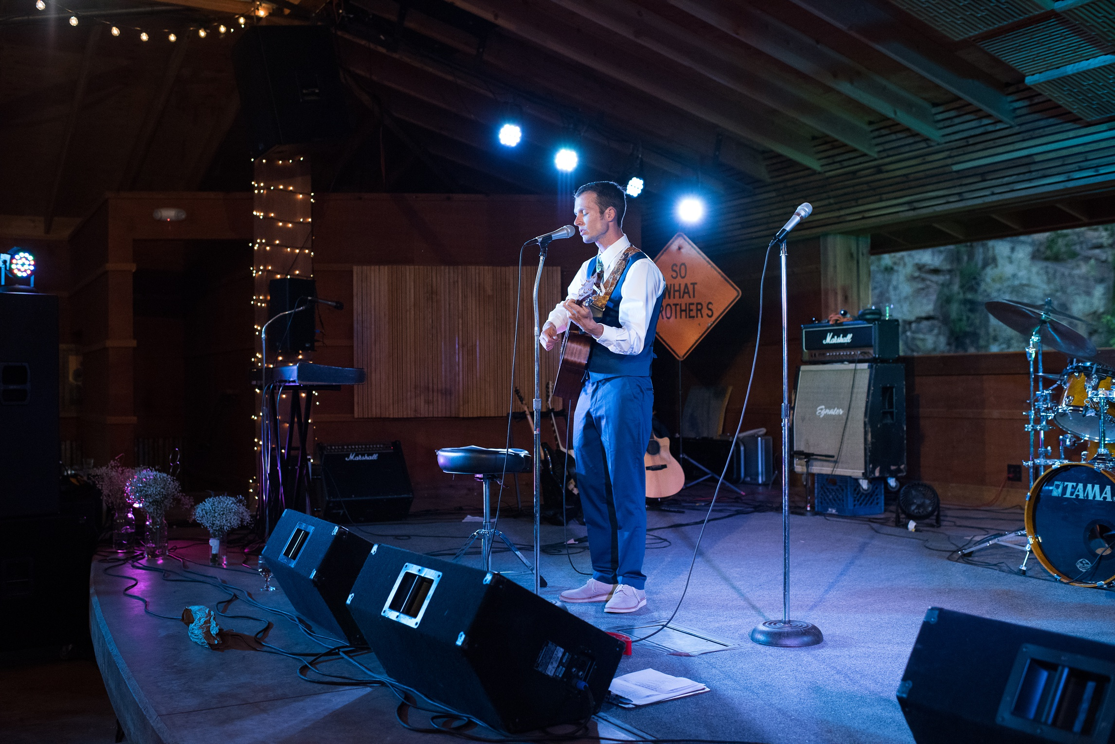 Patrick serenades Melissa on their wedding day at Planet Bluegrass in Lyons, Colorado. Wedding photography by Sonja Salzburg of Sonja K Photography.