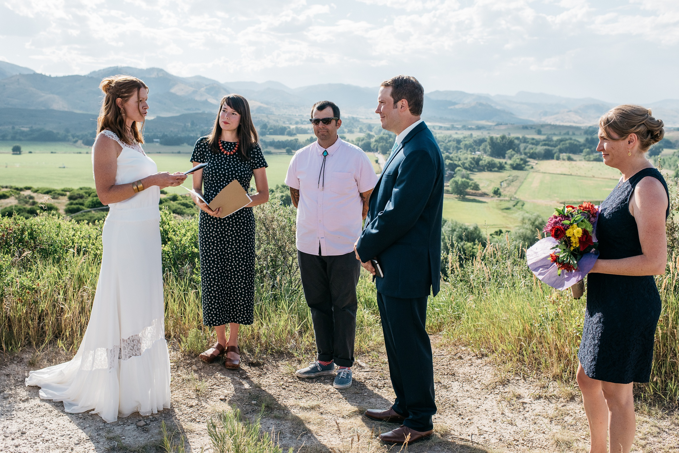 A bride reads her vows at Bingham Hill outside Fort Collins, Colorado. Wedding photography by Sonja Salzburg of Sonja K Photography.