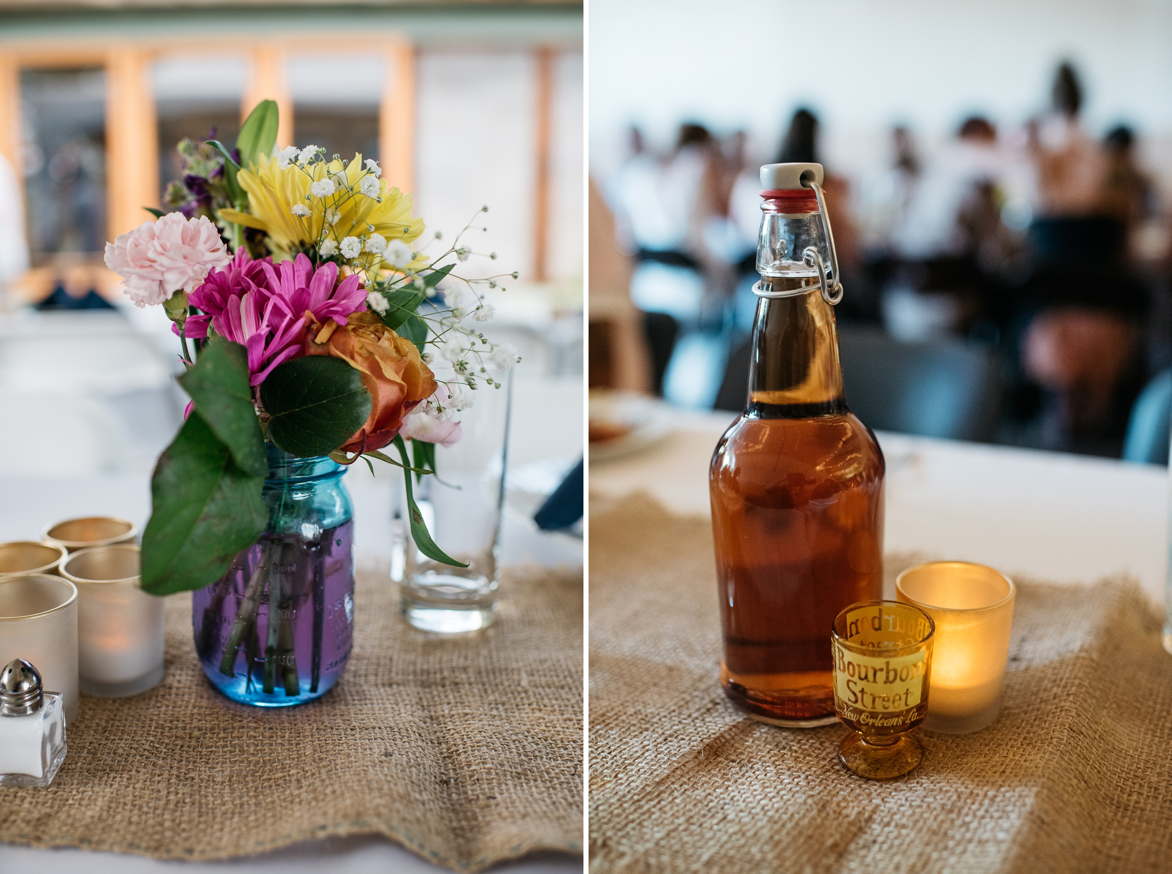 A bright centerpiece of flowers and homemade moonshine at a wedding reception at the Bellvue Grange in Bellvue, Colorado. Wedding detail photography by Sonja Salzburg of Sonja K Photography.