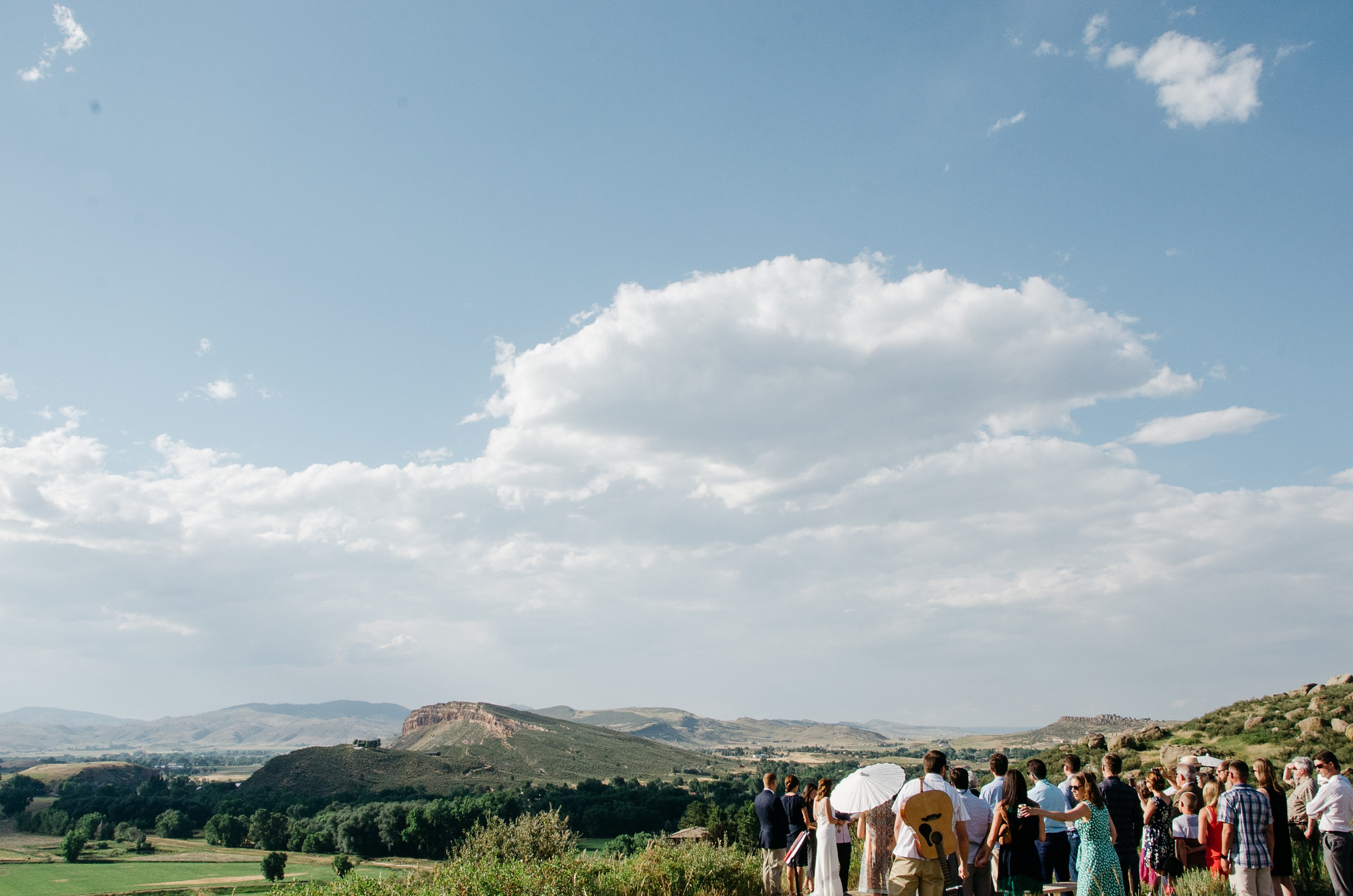 A wedding with an expansive view from Bingham Hill outside Fort Collins, Colorado. Wedding photography by Sonja Salzburg of Sonja K Photography.