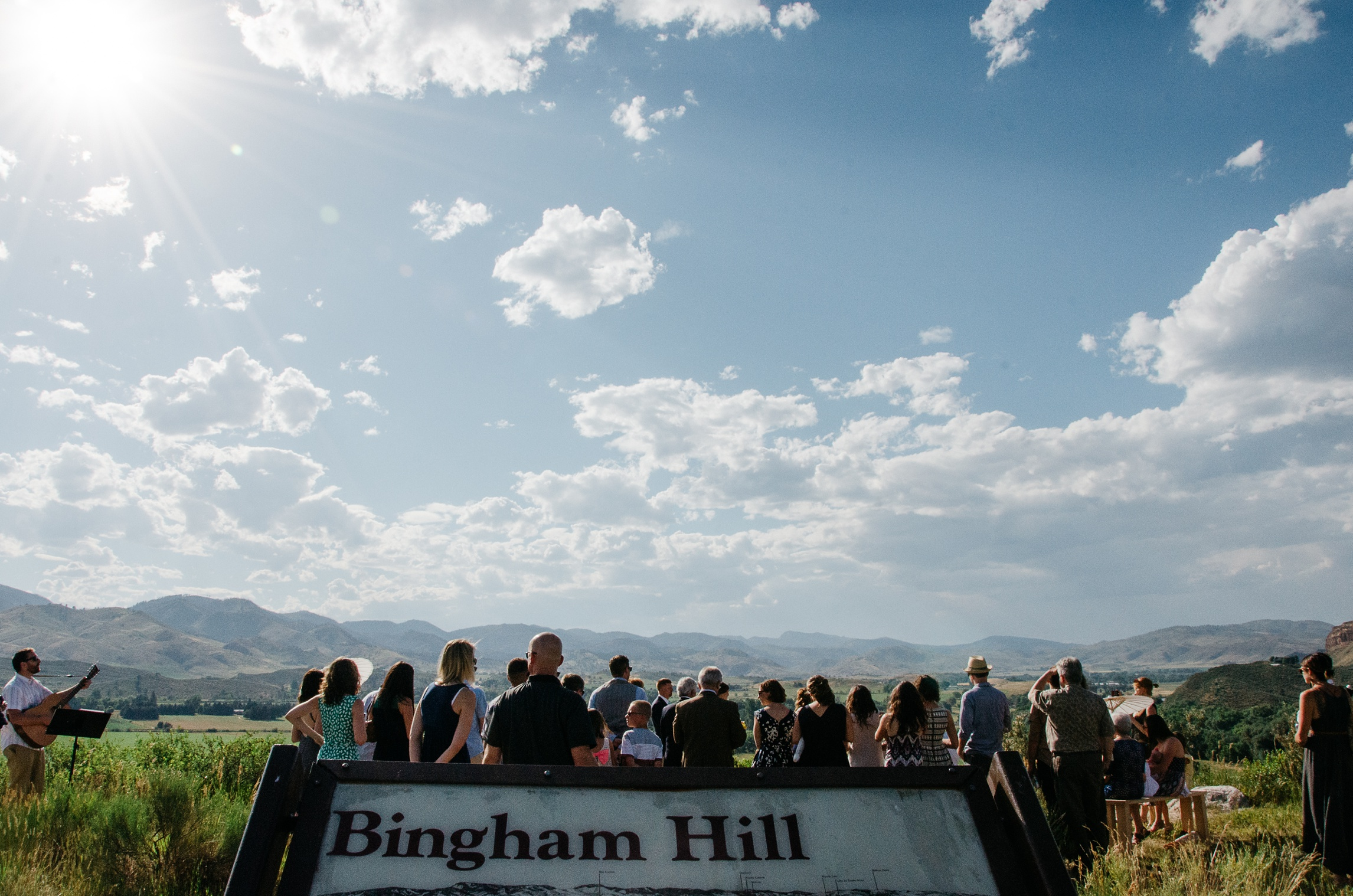 A wedding with an expansive view on top of Bingham Hill outside Fort Collins, Colorado. Wedding photography by Sonja Salzburg of Sonja K Photography.