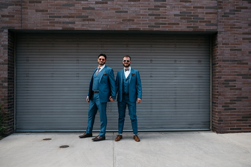 Karl and Weston on their wedding day at Confluence Park in Denver, Colorado. Wedding photography by Sonja Salzburg of Sonja K Photography.