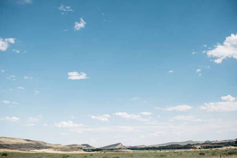 The lonely and expansive view of the northern front range outside Fort Collins, Colorado. Wedding detail photography by Sonja Salzburg of Sonja K Photography.