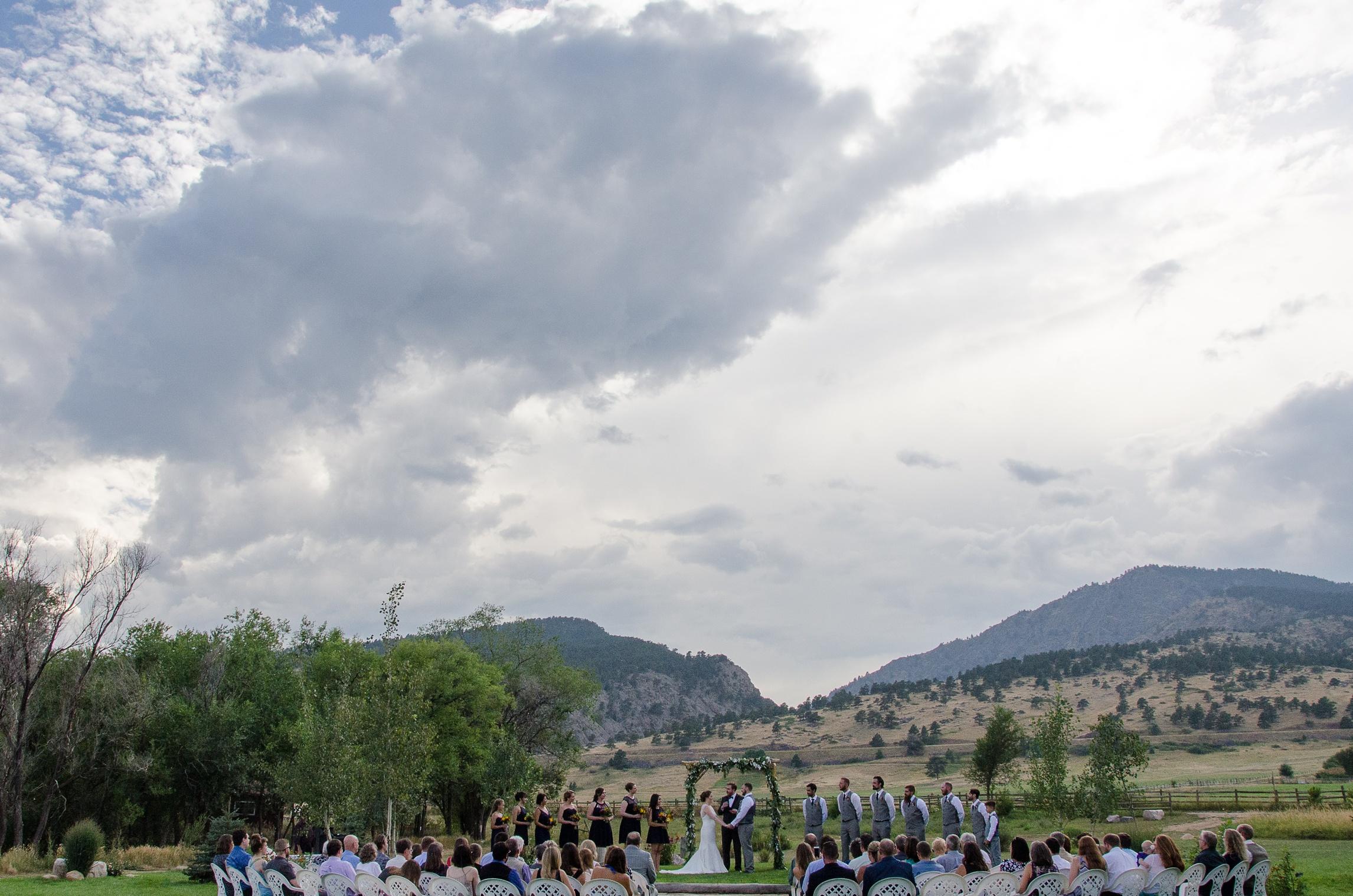 A summer wedding at Sylvan Dale Guest Ranch near Loveland, Colorado. Wedding photography by Max Salzburg of Sonja K Photography.