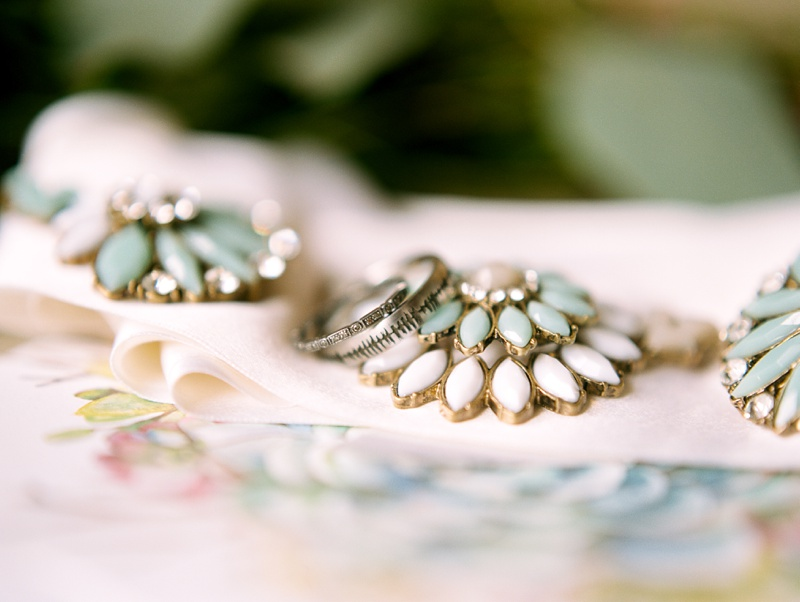 silver vintage wedding bands sit on top of the bride's turquoise jewelry for a Camp Hale wedding in Colorado- photography by Sonja Salzburg of Sonja K Photography
