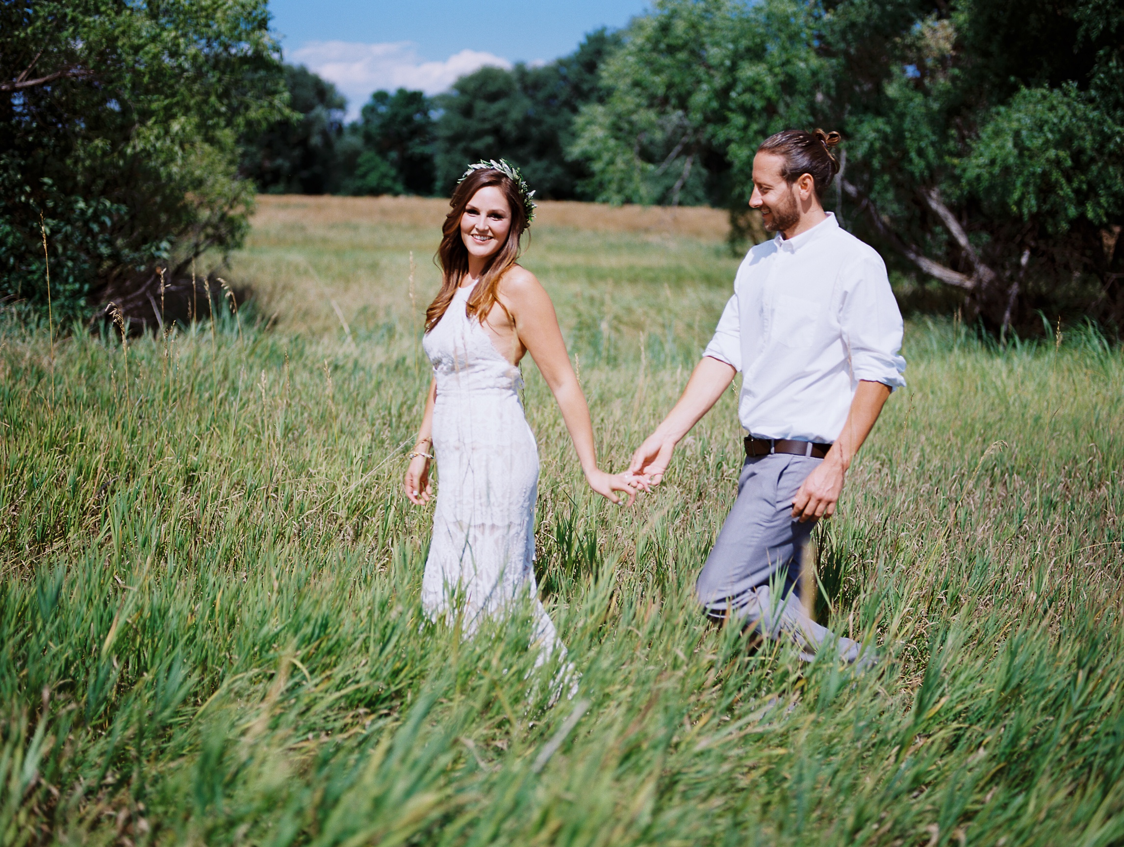 A bride and groom at their outdoor Colorado wedding in Old Town Fort Collins. Wedding photography by Sonja Salzburg of Sonja K Photography.