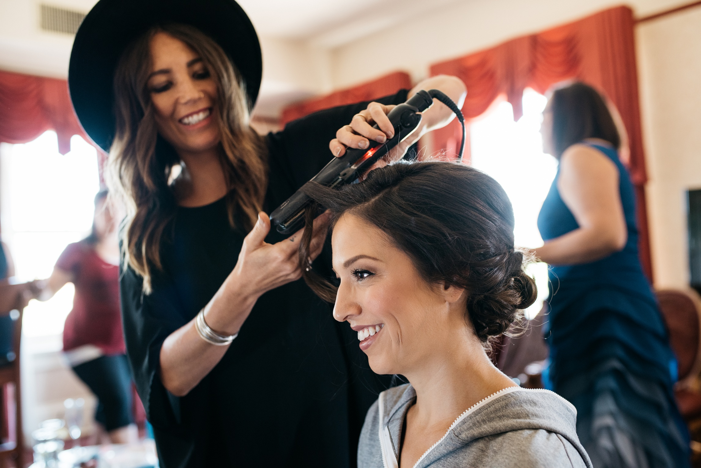 Emmy Swenson of Sage Studio in Boulder Colorado does the brides hair on her wedding day. Wedding photography by Sonja Salzburg of Sonja K Photography.