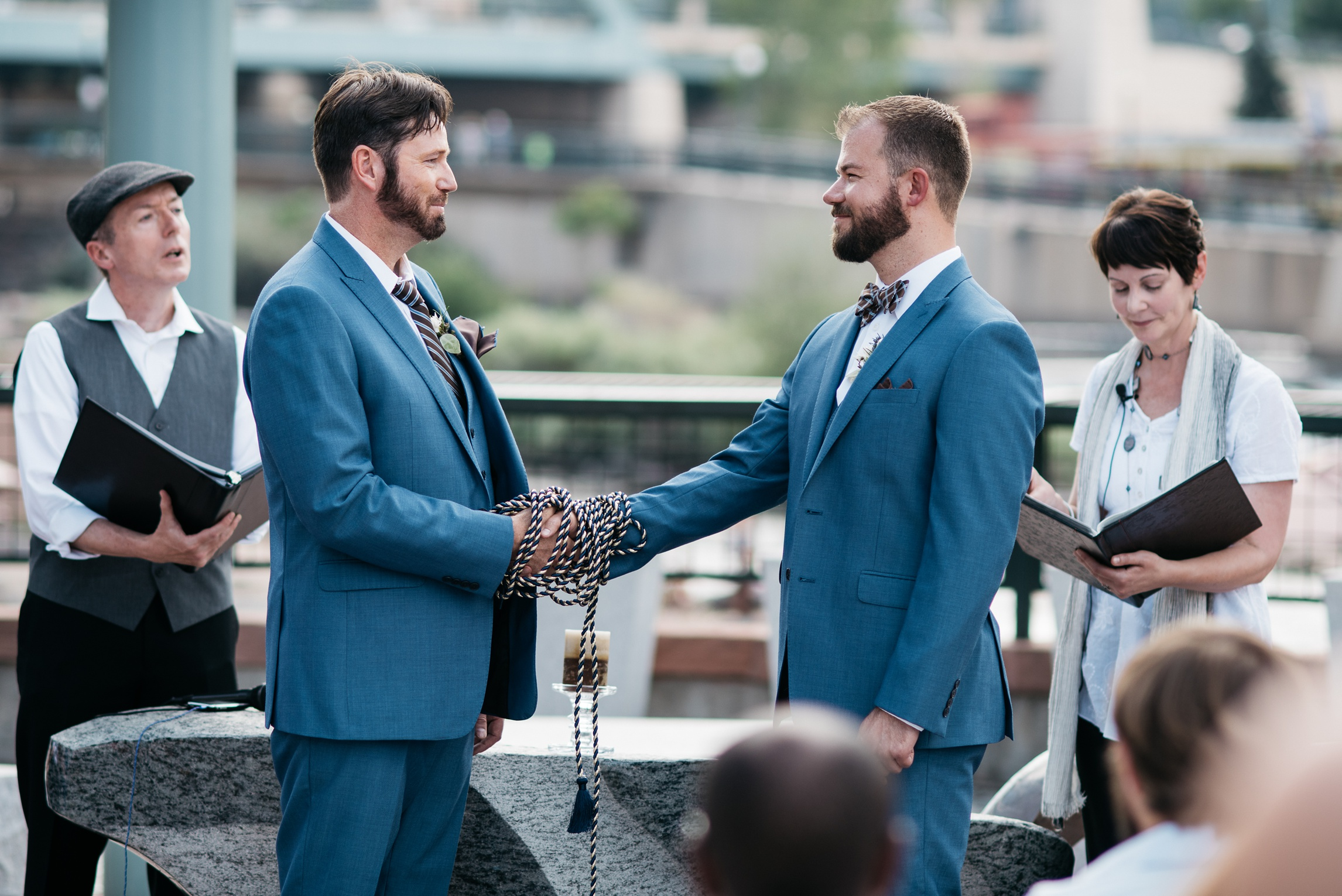 Weston and Karl participate in a wedding Handfasting Ceremony. Wedding photography by Sonja Salzburg of Sonja K Photography.