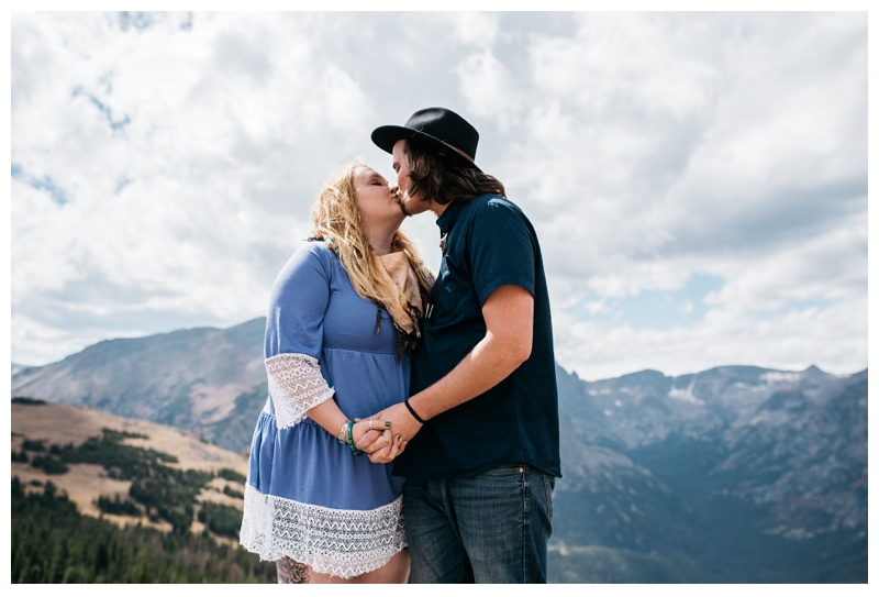 Stephanie and Daniel kiss in Rocky Mountain National Park in Colorado. Engagement photography by Sonja Salzburg of Sonja K Photography.