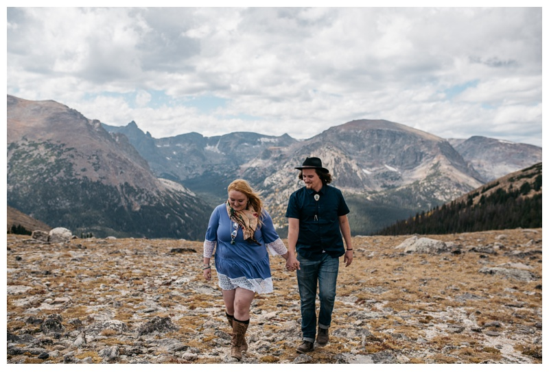 Stephanie and Daniel walk at Moraine Park in Rocky Mountain National Park in Colorado. Engagement photography by Sonja Salzburg of Sonja K Photography.