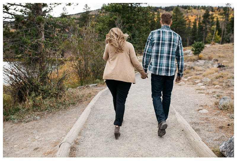 Michael and Miranda walk the Sprague Lake Trail in Rocky Mountain National Park. Engagement photography by Sonja Salzburg of Sonja K Photography.