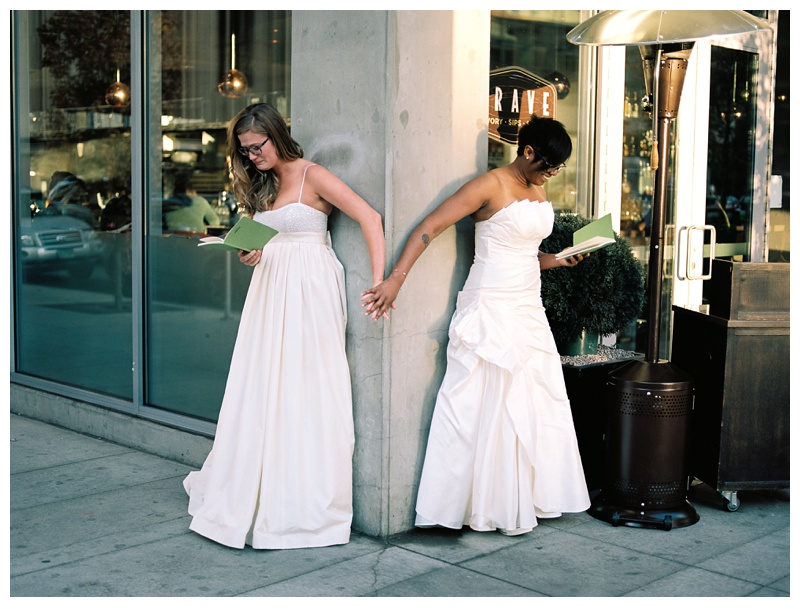 Two brides read poetry to each other at their first look before they get married at SPIRE Denver. Wedding photography by Sonja Salzburg of Sonja K Photography.