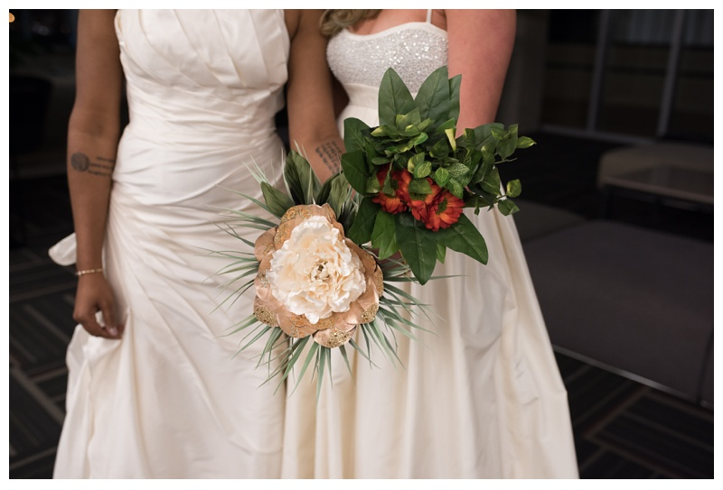 Ali and Kinya with their flowers from their wedding. Wedding photography by Sonja Salzburg of Sonja K Photography.