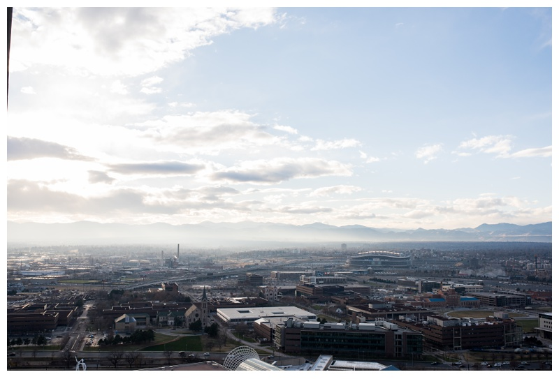The city of Denver, Colorado from the SPIRE building. Wedding photography by Sonja Salzburg of Sonja K Photography.