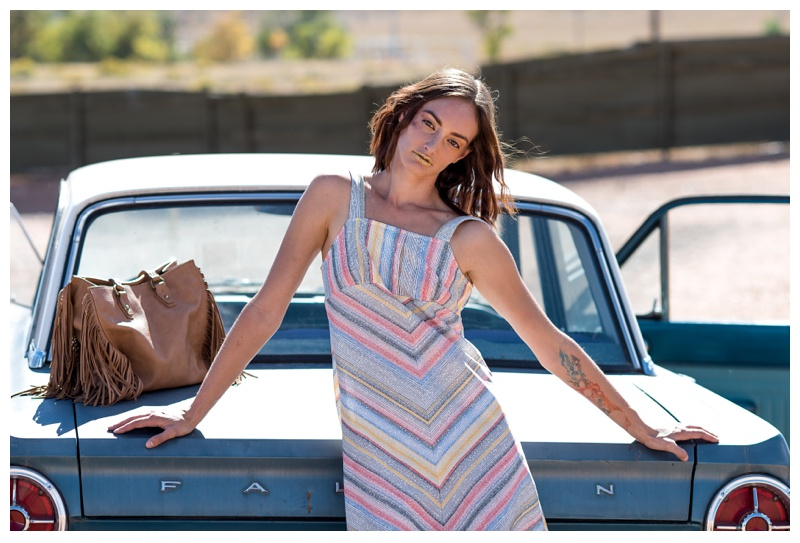 A fashion model at a styled shoot at the Holiday Twin Drive-In in Fort Collins, Colorado. Hair by Ray Hornback and Erik Lindstrom of Voltage Salon. Fashion portrait photography by Sonja Salzburg of Sonja K Photography.