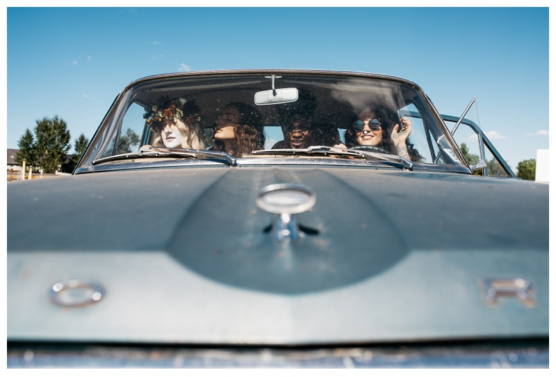 Models in a Ford Falcon at a styled shoot at the Holiday Twin Drive-In in Fort Collins, Colorado. Fashion portrait photography by Sonja Salzburg of Sonja K Photography.