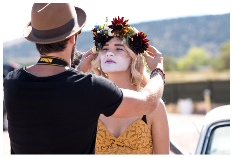 Ray Hornback does a model's hair at a styled shoot at the Holiday Twin Drive-In in Fort Collins, Colorado. Fashion photography by Sonja Salzburg of Sonja K Photography.