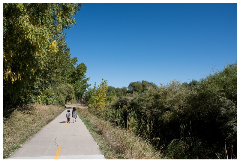Children walk on the Spring Creek Trail in Fort Collins, Colorado. Family portrait photography by Sonja Salzburg of Sonja K Photography.