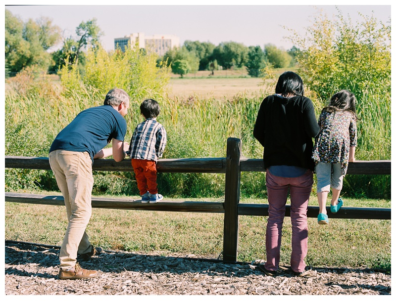 A family spends time together at the Gardens on Spring Creek in Fort Collins, Colorado. Family portrait photography by Sonja Salzburg of Sonja K Photography.