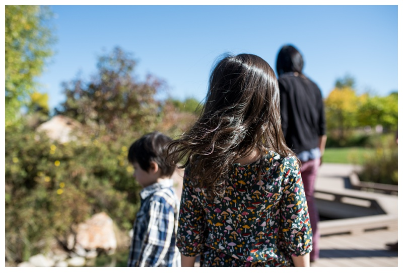 A cute family spends time together at the Gardens on Spring Creek in Fort Collins, Colorado. Family portrait photography by Sonja Salzburg of Sonja K Photography.
