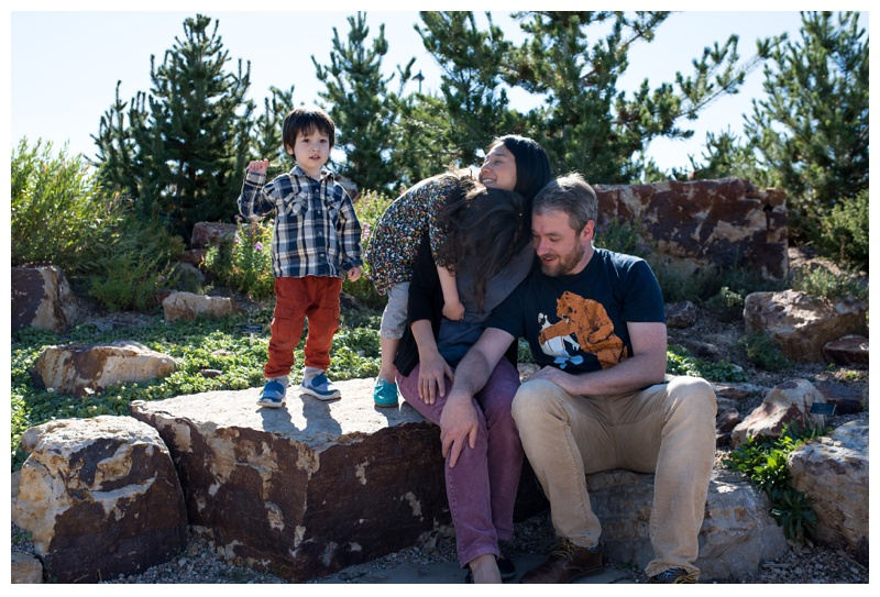 A happy family plays at the Gardens on Spring Creek in Fort Collins, Colorado. Family portraits by Sonja Salzburg of Sonja K Photography.
