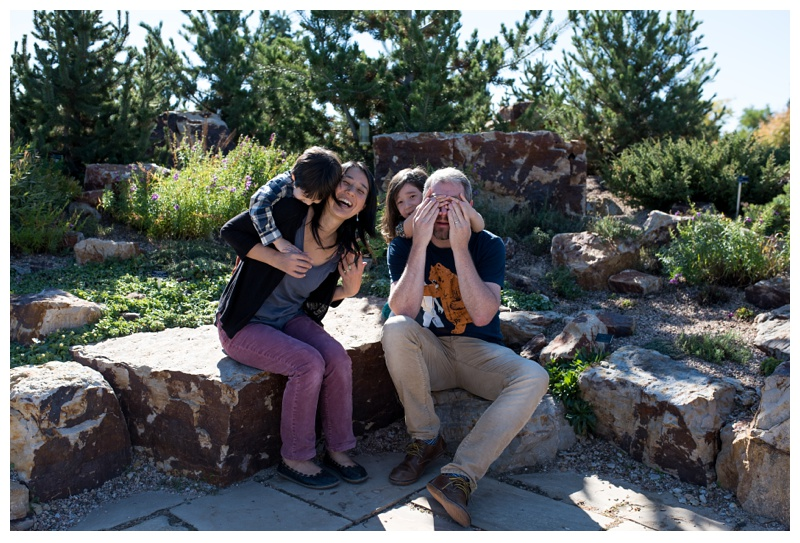An adorable happy family on a bright sunny Fort Collins, Colorado day. Family portraits by Sonja Salzburg of Sonja K Photography.
