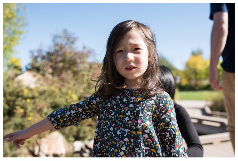 An adorable little girl on a sunny day in Fort Collins, Colorado. Family portrait photography by Sonja Salzburg of Sonja K Photography.