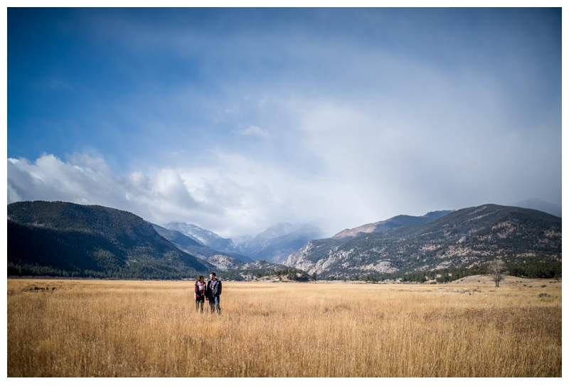 An engaged couple at Moraine Park in Rocky Mountain National Park in Colorado. Engagement photography by Sonja Salzburg of Sonja K Photography.