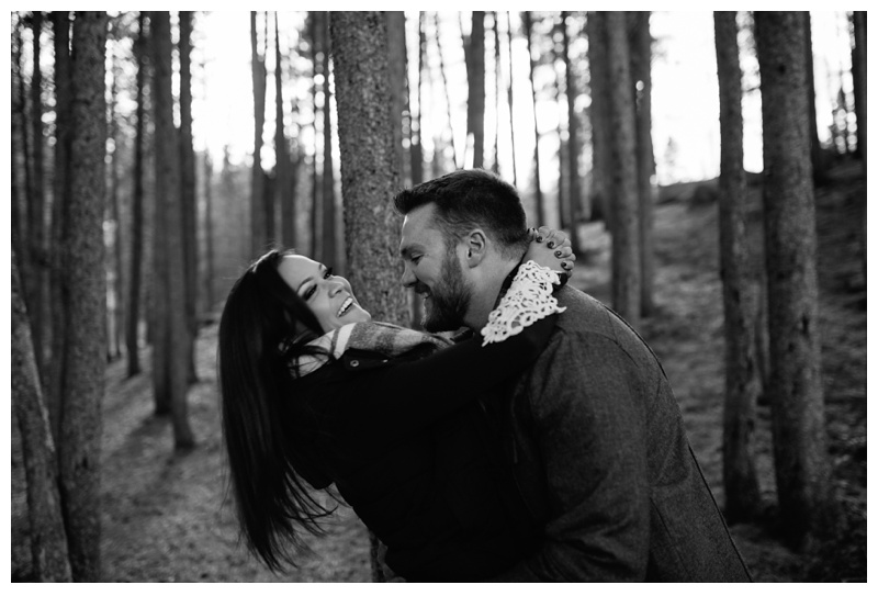 An engaged couple play in Rocky Mountain National Park in Colorado. Engagement photography by Sonja Salzburg of Sonja K Photography.