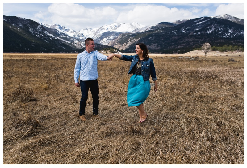 A happily engaged couple near Trail Ridge Road in Rocky Mountain National Park in Colorado. Engagement photography by Sonja Salzburg of Sonja K Photography.