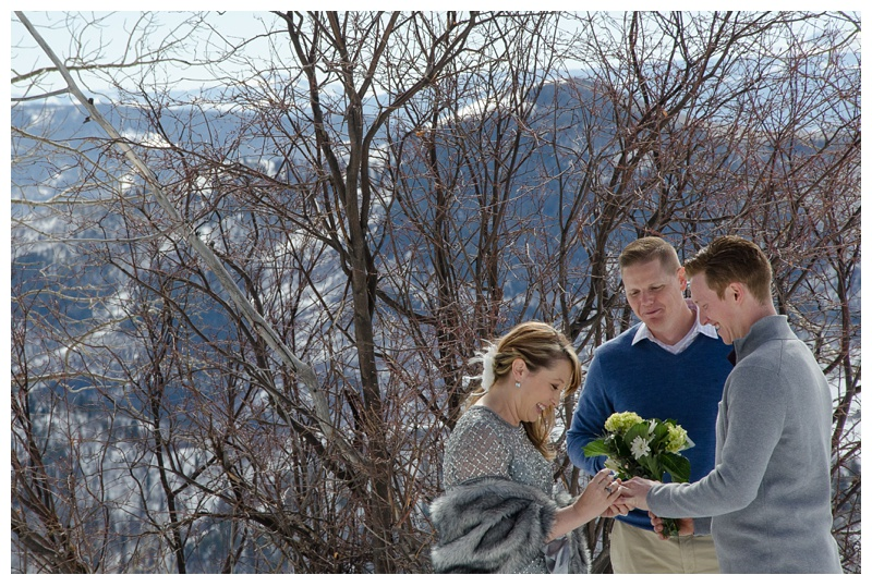 A wedding ceremony on Rabbit Ears Pass outside of Steamboat Springs, Colorado. Wedding photography by Sonja Salzburg of Sonja K Photography.