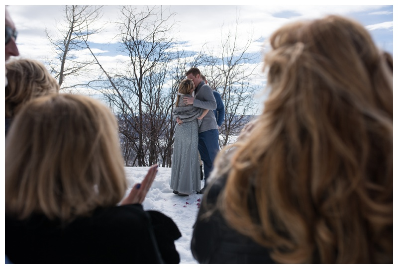 A winter wedding ceremony at Rabbit Ears Pass outside of Steamboat Springs, Colorado. Wedding photography by Sonja Salzburg of Sonja K Photography.