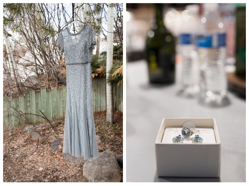 A dress and wedding day jewelry on a wedding day in Steamboat Springs, Colorado. Wedding photography by Sonja Salzburg of Sonja K Photography.