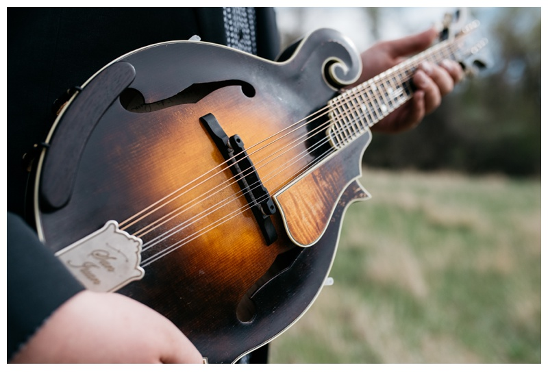 Eli Slocumb's mandolin in Lee Martinez Park in Fort Collins, Colorado. Portrait photography by Sonja Salzburg of Sonja K Photography.