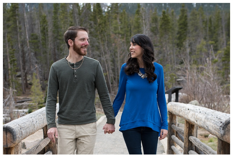 A newly engaged couple at an engagement session in Rocky Mountain National Park near Estes Park, Colorado. Wedding engagement photography by Sonja Salzburg of Sonja K Photography.