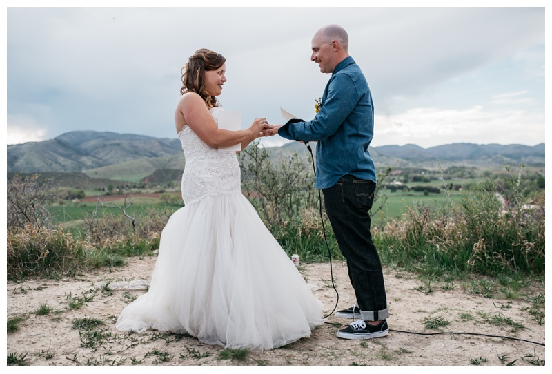 Justin and Katie get married on top of Bingham Hill outside of Fort Collins. Colorado. Wedding photography by Sonja Salzburg of Sonja K Photography.