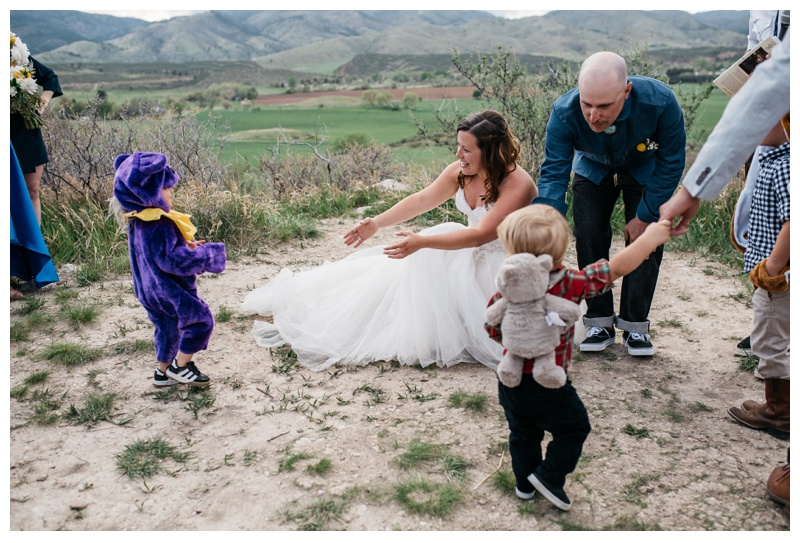 """Katie and Justin welcome the """"Ring Bears"""" to their wedding at Bingham Hill outside of Fort Collins, Colorado. Wedding photography by Sonja Salzburg of Sonja K Photography."""