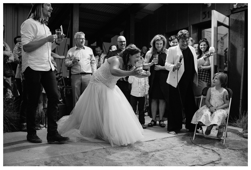 The bride during toasts at Wolverine Farm Letterpress and Publick House in Fort Collins, Colorado. Wedding photography by Sonja Salzburg of Sonja K Photography.