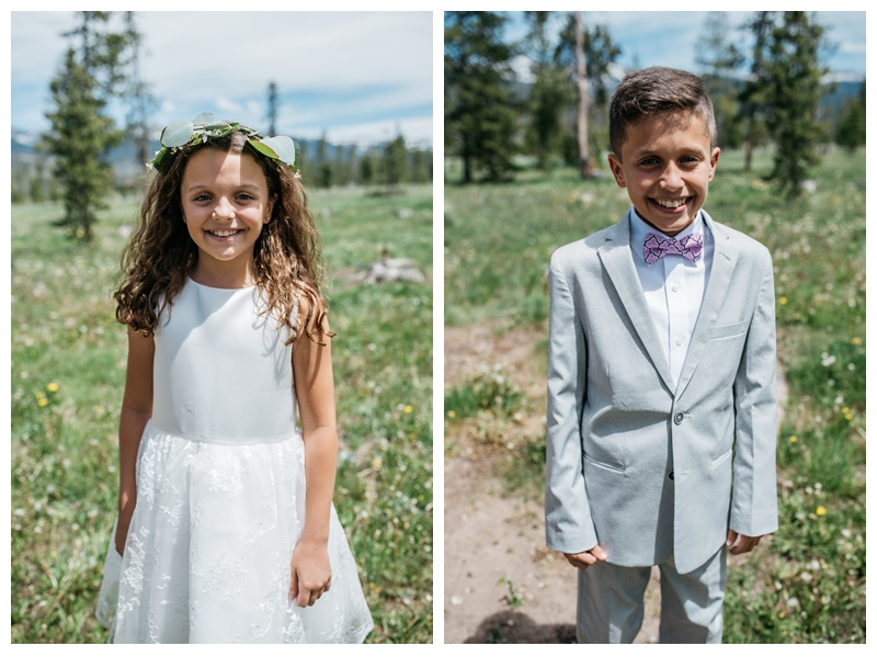 The flower girl and the ring bearer at a wedding at Wild Horse Inn outside of Winter Park, Colorado. Wedding photography by Sonja Salzburg of Sonja K Photography.
