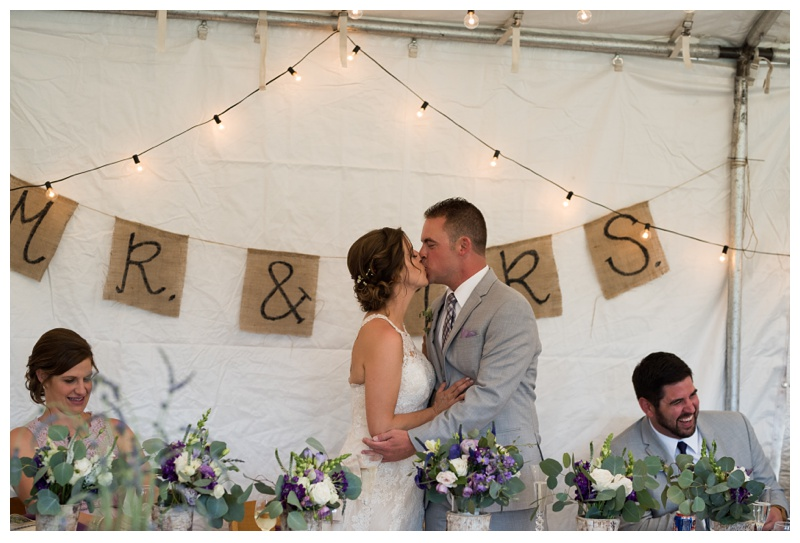 A bride and groom kiss at their wedding at Wild Horse Inn outside of Winter Park, Colorado. Wedding photography by Sonja Salzburg of Sonja K Photography.