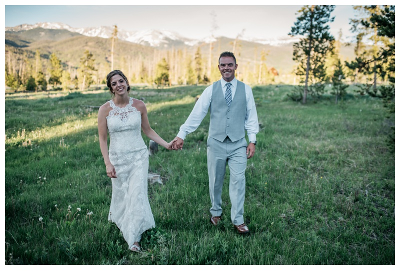A bride and groom married in the Colorado mountains at Wild Horse Inn near Winter Park, Colorado. Wedding photography by Sonja Salzburg of Sonja K Photography.