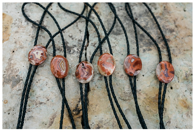 Handmade Fairburn Agate bolo ties for the groomsmen made by the bride's grandfather. Wedding detail photography by Sonja Salzburg of Sonja K Photography.