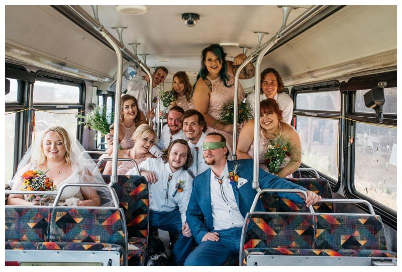 The wedding party on a bus, at a farm near Platteville, Colorado. Wedding photography by Sonja Salzburg of Sonja K Photography.