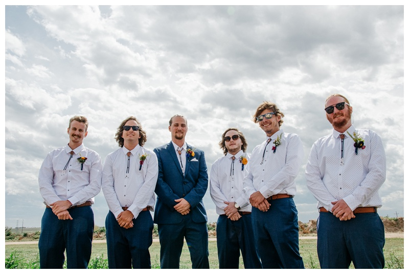 The groom and the groomsmen on his wedding day near Platteville, Colorado. Wedding photography by Sonja Salzburg of Sonja K Photography.