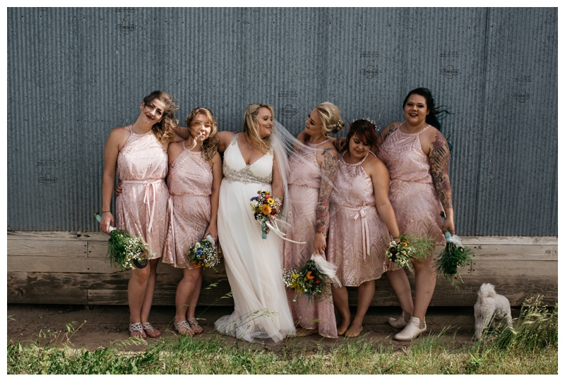 The bride and her brides maids on her wedding day at a farm near Meadows Event Center outside of Platteville, Colorado. Wedding photography by Sonja Salzburg of Sonja K Photography.