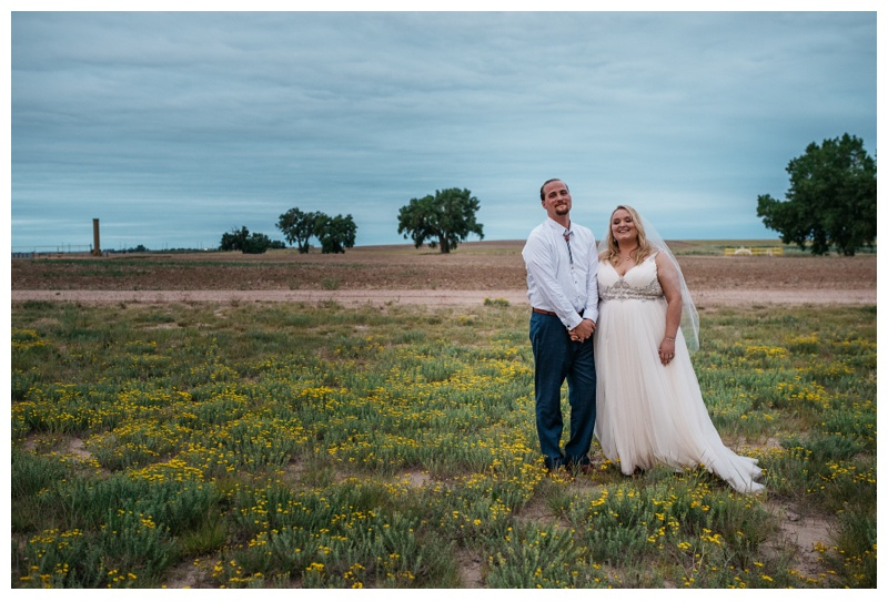 A bride and groom on their wedding day near Platteville, Colorado at Meadows Event Center. Wedding photography by Sonja Salzburg of Sonja K Photography.