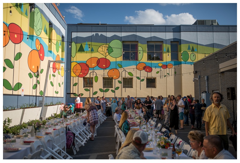 The poppy mural in the plaza behind FirstBank Downtown Fort Collins, Colorado is host to Fortified Collaborations 1st Sunday Supper. Event photography by Sonja Salzburg of Sonja K Photography.