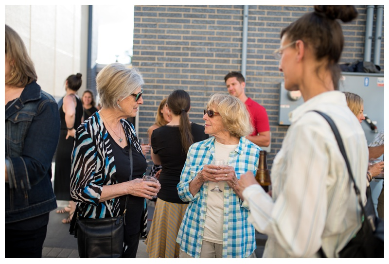 People mingle at the 1st Sunday Supper by Fortified Collaborations in Fort Collins, Colorado. Event photography by Sonja Salzburg of Sonja K Photography.